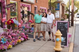 John, Veronica, and Art in front of Sissy's Consignment store.